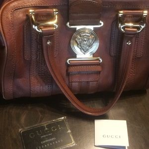 Real Gucci bag with tags of authenticity